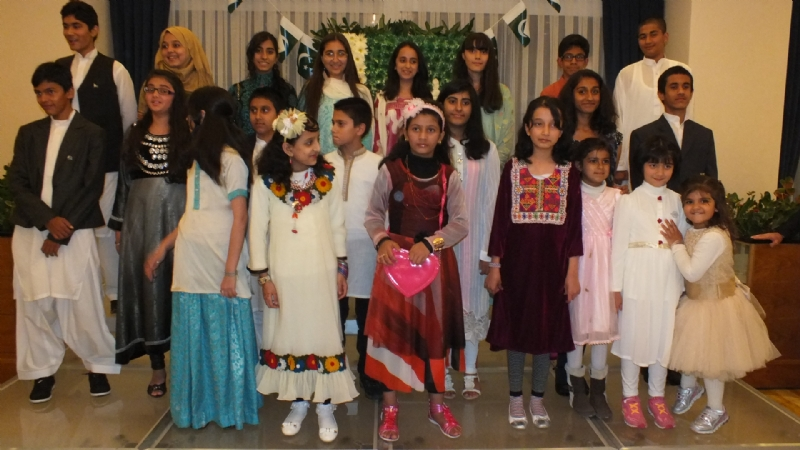 Pakistan Embassy school students performing national anthem of Pakistan during defence day