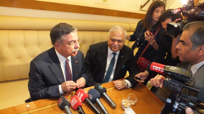Turkish Defence Minister flanked by Ambassador Haroon Shaukat speaking to media.