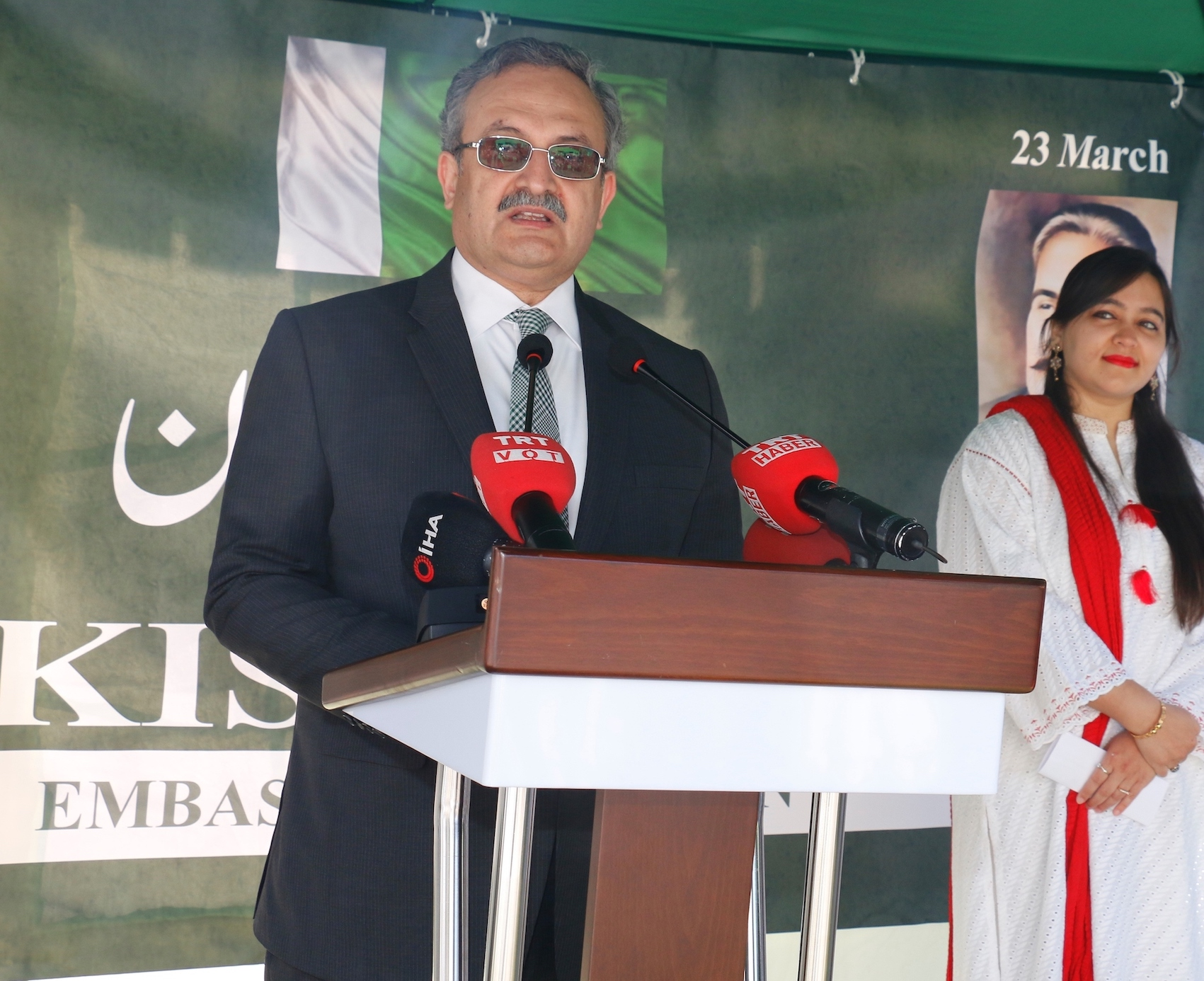Ambassador Syrus Qazi welcoming guests during Pakistan Day flag hoisting ceremony